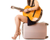 Music lover, summer girl with guitar and suitcase — Stock Photo