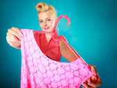 Pinup girl buying clothes pink dress. Sale retail. — Stock Photo