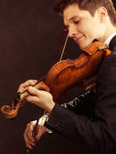 Man violinist playing violin. Classical music art — Stockfoto