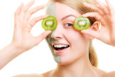 Skin care. Woman in clay mask with kiwi on face — Foto Stock