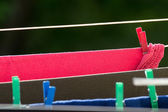 Clean laundry hanging to dry on line outdoor — Stock Photo