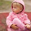 Little Girl on Park Bench — Stock Photo