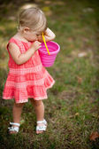 Little girl playing with pail — Stock Photo