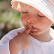 Little girl eating chocolate — Stock Photo #19241551