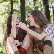 Two girlfriends outdoor laughing — Stock Photo #20405815