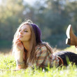 Beautiful Young Woman lying on grass with closed eyes - Foto Stock