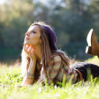 Beautiful Young Woman lying on grass — Stockfoto