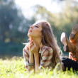 Beautiful Young Woman lying on grass with closed eyes — Stock Photo #20405847