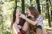 Two girlfriends outdoor laughing — Stock Photo