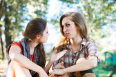 Two girlfriends outdoor talking — Stock Photo