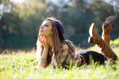 Beautiful Young Woman lying on grass — Stock Photo