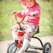 Little girl on tricycle — Stock Photo