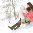 Mother and her child on snow — Stock Photo