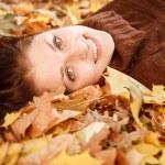 Teenage girl lying down on leaves — Stock Photo #37977521