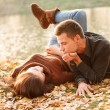 Foto Stock: Young couple lying down outdoors