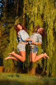 Two teenage girls jumping — Stock Photo