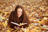 Young female reading book — Stock Photo