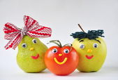 Funny tomato, apple and pear on a white background — Stock Photo