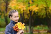 Portrait of Girl with maple leaves — Photo