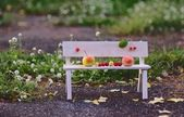 Apples Family sitting on the Bench — Stock Photo