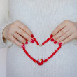Red heart on belly — Stock Photo