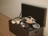 The braun Box with shoes on the wooden floor — Stock Photo