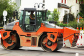 Road renewing Steamroller over a fresh asphalt layer — Stock Photo