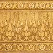 Gold Metal Plate with Thai Traditional Carving in Contemporary style — Stock Photo #27239951