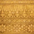 Gold Metal Plate with Thai Traditional Carving in Contemporary style — Stock Photo #27240121