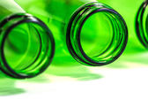 Extra Closeup of Green Bottles on White Background with focus on center bottle — Stock Photo