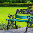 Green Bench in Park with Green Lawn Background — Photo #27542799