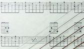 Guitar Strings on Old Yellowed Music Sheet no Lyrics, Closeup — Stock Photo