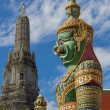 Stock Photo: Guardistatue with Temple of Dawn background, Thailand