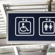 General and Handicap Accessible Elevator Directional Sign, Closeup — Stock Photo #28772033