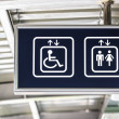 Stock Photo: General and Handicap Accessible Elevator Directional Sign, Closeup