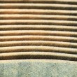 Stock Photo: Closeup Horizontal Grooves of a Used Air Filters showing Material Textures