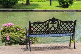 Bench near the Lake in the Tropical Garden — Stock Photo
