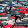 Stock Photo: Brand new Motor Vehicles crowed in Parking lot waiting for Distribution to Dealers