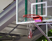 Basketball hoop with net damaged. — Stock Photo