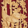 Mythical Thai Style Carving on red Wooden Wall, General Thai Temple Art — Stock Photo
