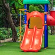 Stock Photo: Red Dual Slides for Children on Green Lawn