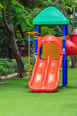 Red Dual Slides for Children on Green Lawn — Stock Photo