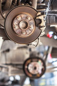 Rusty Brake Disc waiting for Maintenance in Service Garage — Stock Photo