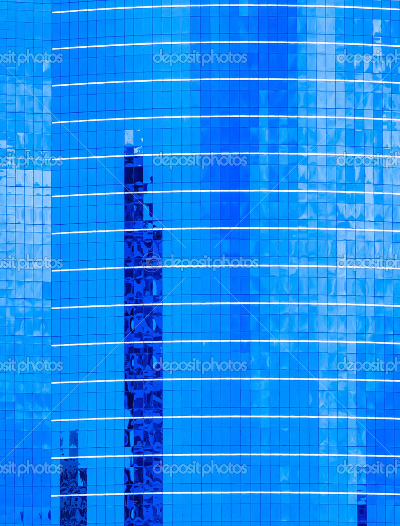 Glass facade with reflection of abstract building stock for Refection facade