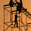 Silhouette of Workmen on assembling concert stage — Stock Photo