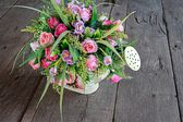 Roses Bouquet in Watering Pot — Stock Photo