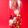 Christmas vase wearing cristmas boll hand — Stock Photo #12757869