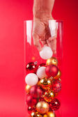 Christmas vase wearing a cristmas boll hand — Stock Photo