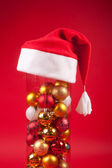 Christmas vase wearing a cristmas hat — Stock Photo