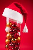 Christmas vase wearing a cristmas hat — Stock Photo